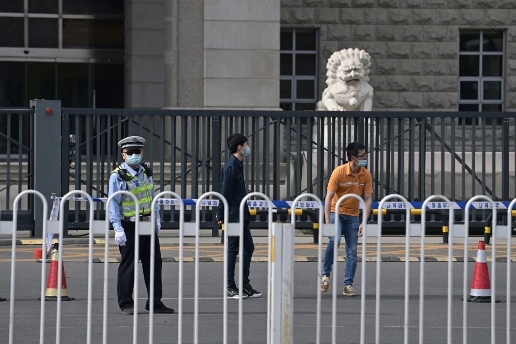 There was heavy security outside the courtroom, with the area around the entrance cordoned off with tape and large numbers of police deployed