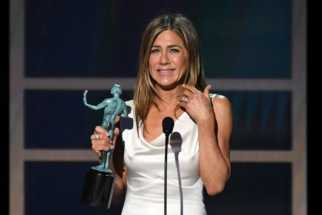 """US actress Jennifer Aniston said she had feelings for her co-star David Schwimmer early on in the making of """"Friends"""