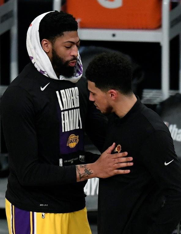 Anthony Davis of the Los Angeles Lakers shakes hands with Devin Booker of Phoenix after the Suns eliminated the Lakers from the NBA playoffs with a 113-100 victory