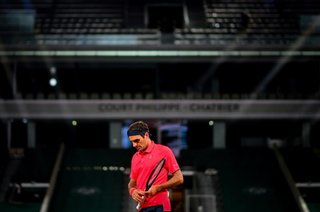 Running on empty: Roger Federer playing against Germany's Dominik Koepfer in an empty Court Philippe Chatrier