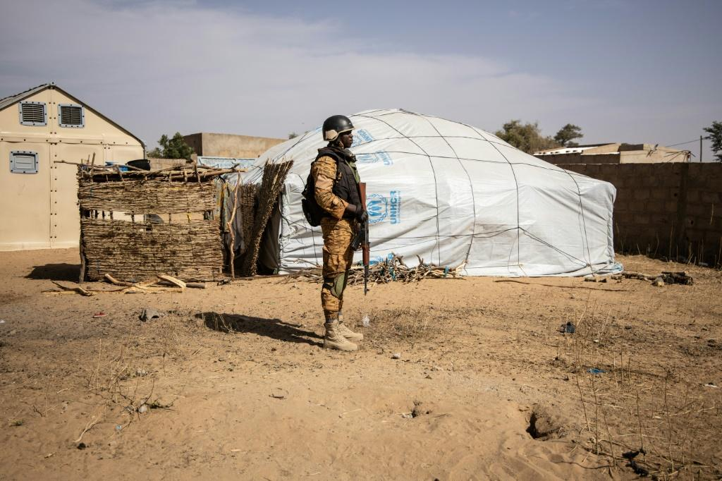 A Burkina Faso soldier patrols at a camp in Dori sheltering people displaced from northern Burkina Faso.