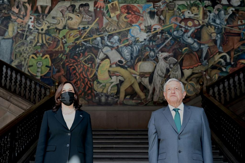 Vice President Kamala Harris and Mexican President Andres Manuel Lopez Obrador arrive at the National Palace for talks