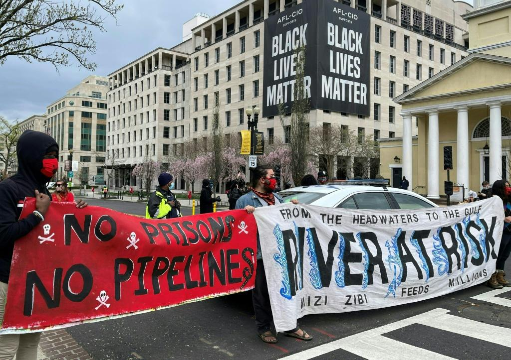Activists in April displayed banners referring to the shutting down of existing oil pipelines in the northern United States at Black Lives Matter Plaza in Washington