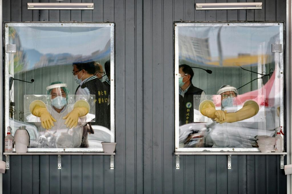 Medical personnel at a coronavirus screening site in New Taipei City