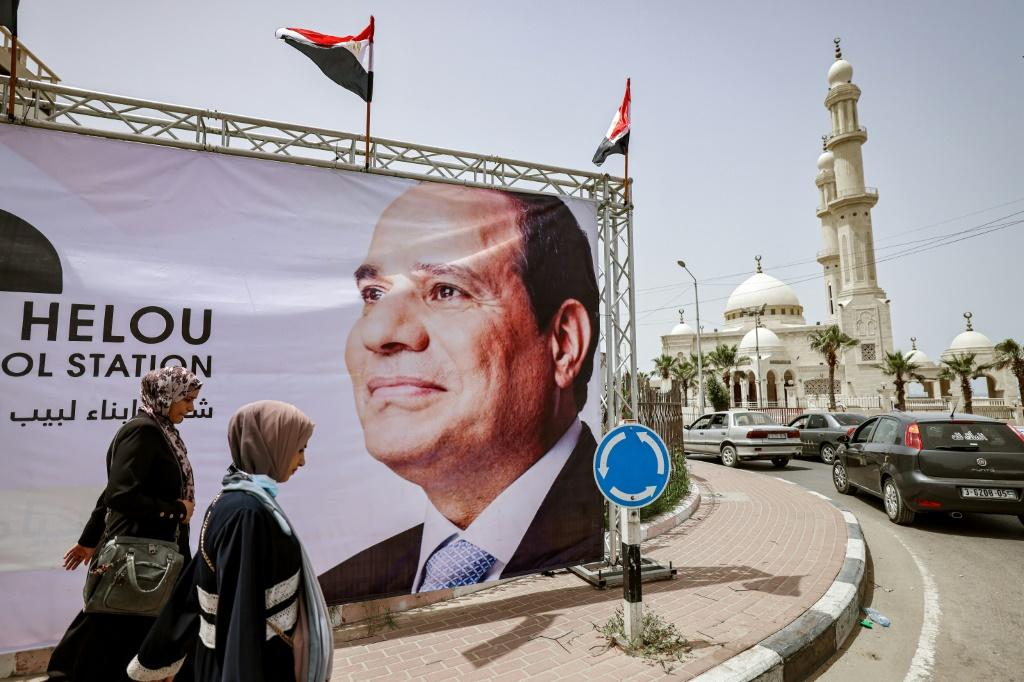 A giant banner depicting Egypt's President Abdel Fattah al-Sisi is seen on display in Gaza City on May 31, 2021