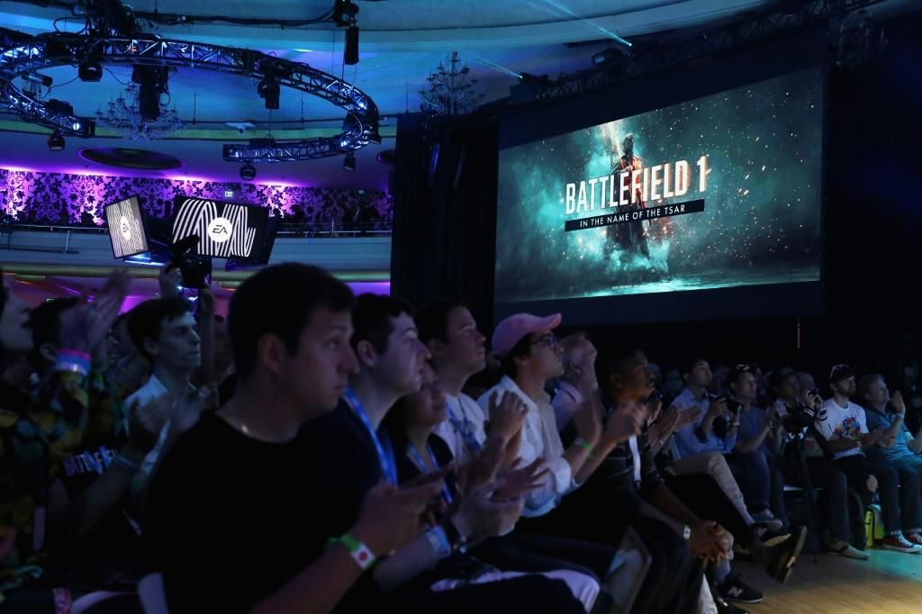 Game enthusiasts and industry personnel watch scenes from 'Battlefield One' during the Electronic Arts EA Play event on June 10, 2017 in Los Angeles, California