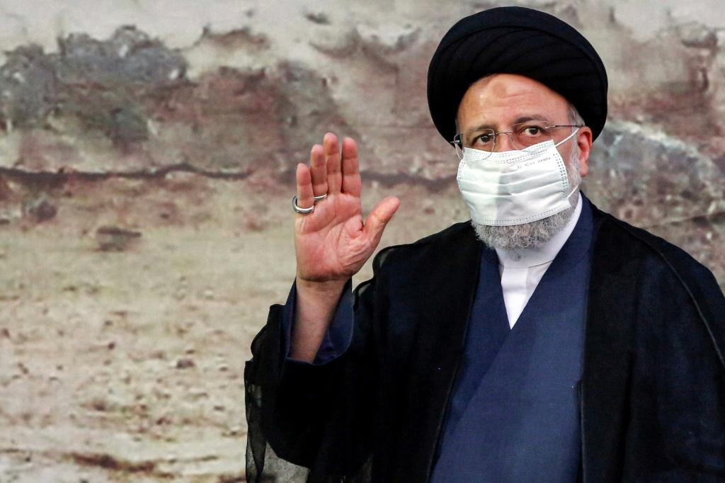 Iranian presidential candidate and frontrunner Ebrahim Raisi greets supporters at an election campaign rally in the city of Eslamshahr, south of Tehran