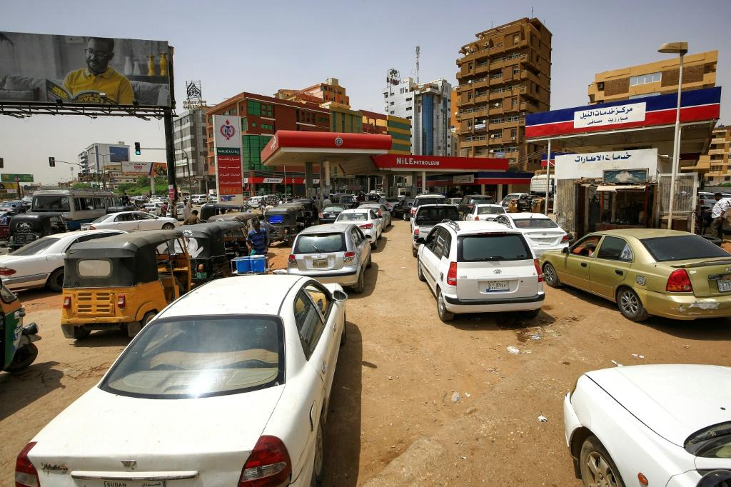 Sudanese queue up at petrol stations to fill up after the government decided to scrap subsidies on petrol and diesel, more that doubling prices