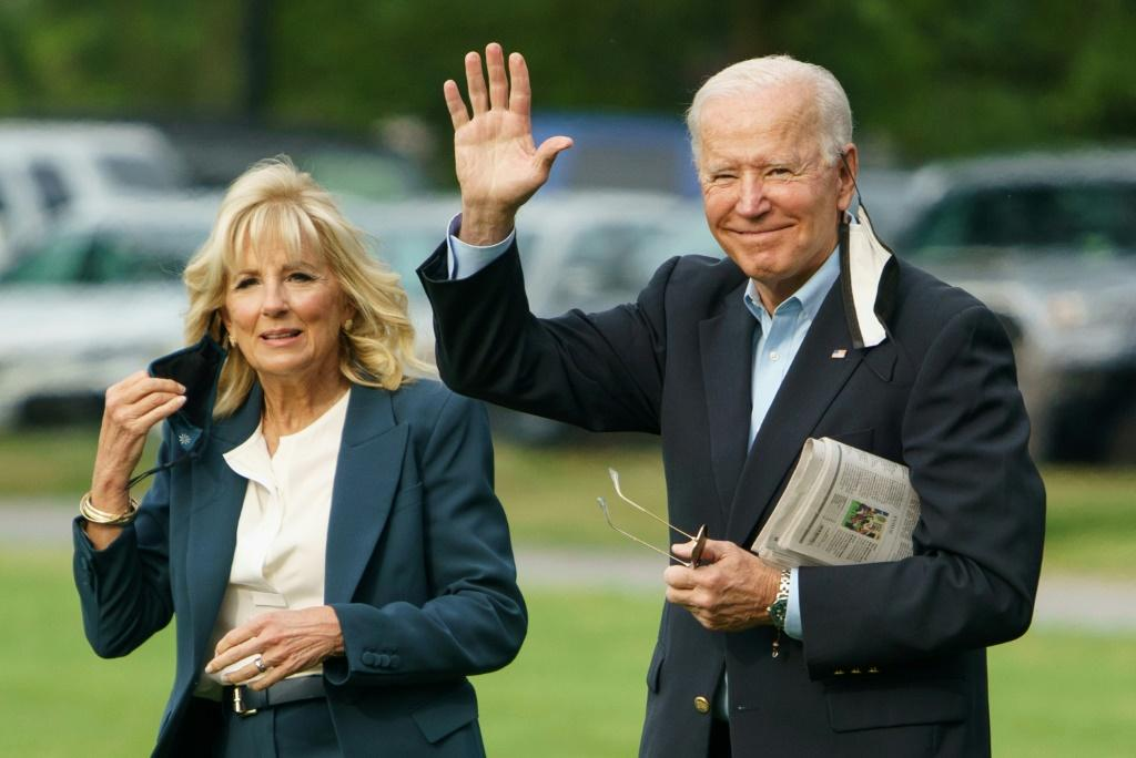 US President Joe Biden (right) campaigned on increasing taxes on the rich