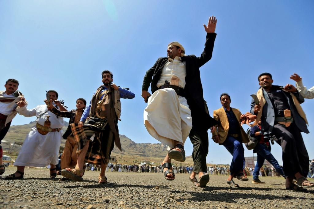 Yemeni fighters loyal to the Iran-backed Huthi rebels perform a traditional dance during a rally to express solidarity with the Palestinians in the capital Sanaa on May 20, 2021