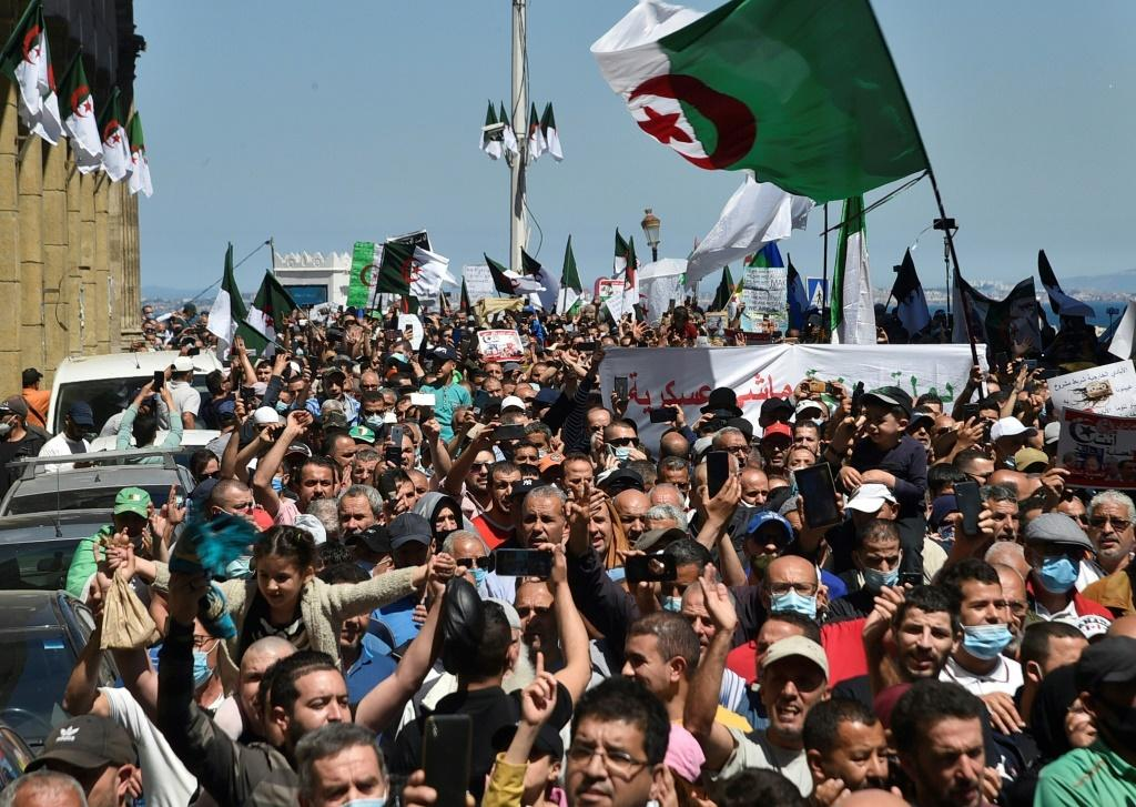 Algerian security forces have deployed in large numbers to ensure polls pass off peacefully, hoping to block anti-government activists, such as these people pictured during a demonstration in the capital Algiers on May 7
