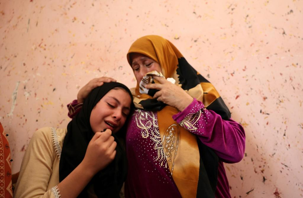 Relatives of Dima Assalia, 11, cry during her funeral following an Israeli air strike in Jabalia in the northern Gaza Strip on May 20