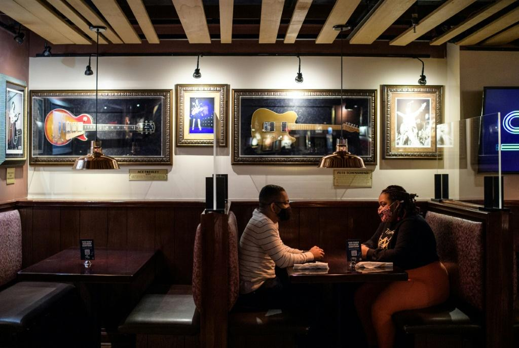 A couple dines indoors at the Hard Rock Cafe in New York City, which reopened in May after being closed for more than a year