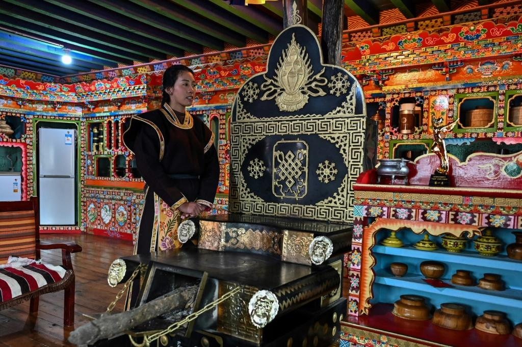 Baima shows off her hotel in the village of Tashigang during a government-organised media trip