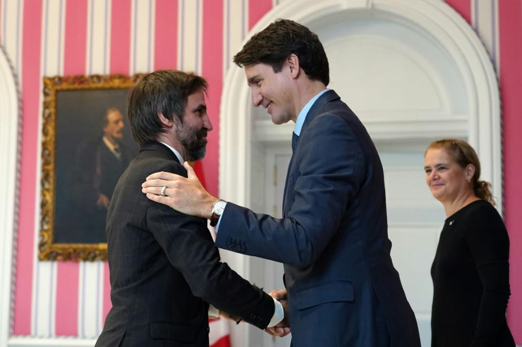 Canadian Heritage Minister Steven Guilbeault, pictured (left) with Prime Minister Justin Trudeau in 2019, says the government is working to hold adult websites to account for their content