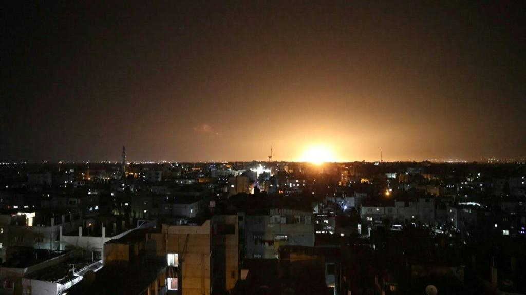 IMAGES An explosion lights up the night sky in Khan Yunis, in the southern Gaza Strip, as Israeli forces shell the Palestinian enclave. The Israeli air force launched air strikes in response to incendiary balloons sent into southern Israel from Gaza, secu