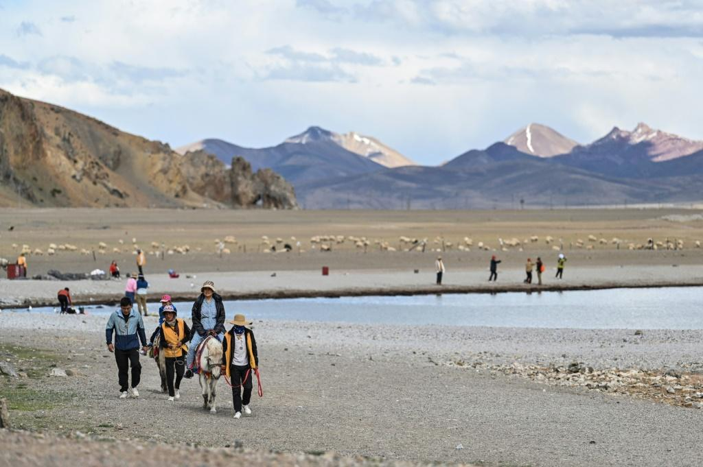 Waves of mainland Chinese travellers have flocked to Tibet, attracted by the scenery, air of mystique and multitude of new transport links
