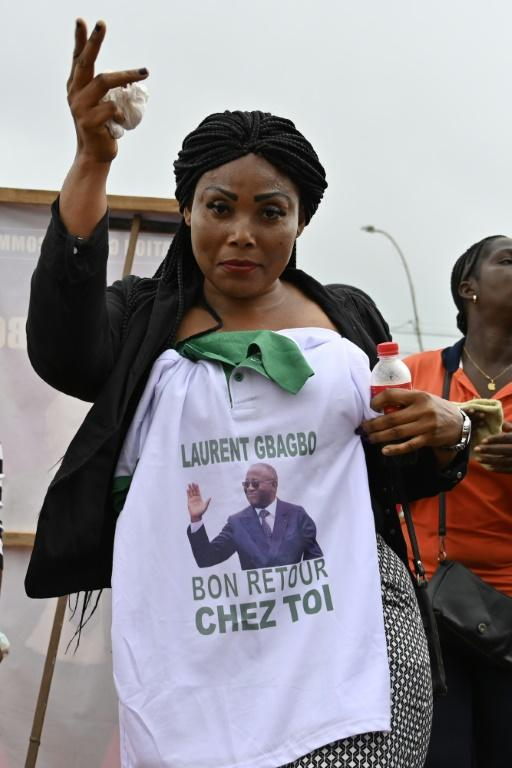 Welcome home: Gbagbo's image is emblazoned on T-shirts, caps and caftans