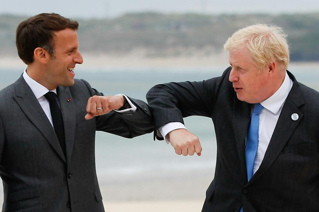 Boris Johnson (R) clashed with European leaders like France's Emmanuel Macron at the weekend in the so-called 'sausage war'