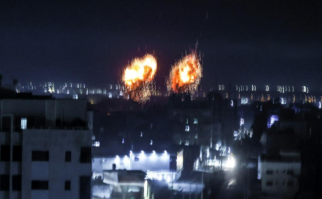 Explosions light up the night sky over Gaza City as Israeli forces shell the Palestinian enclave