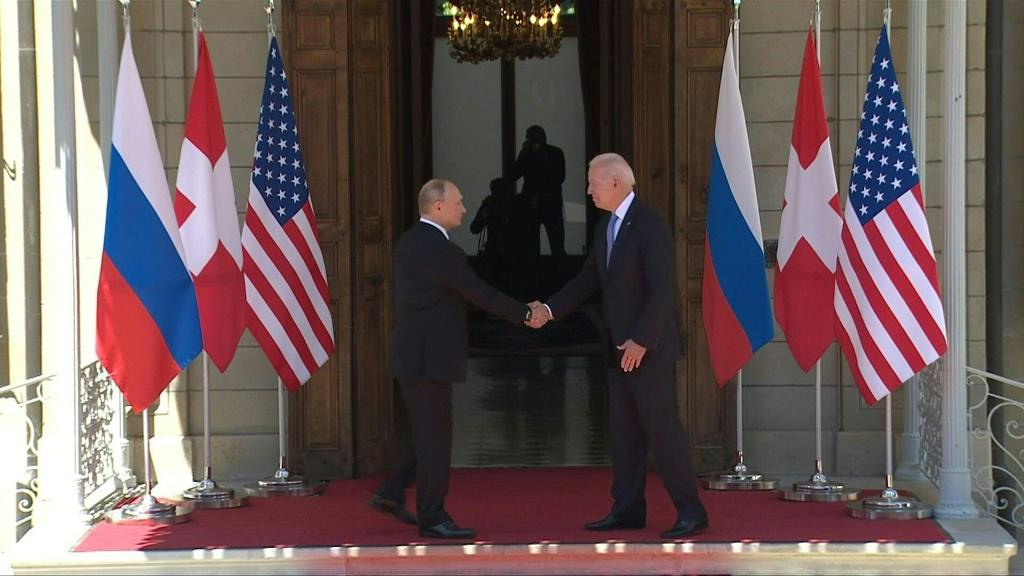 IMAGESUS President Joe Biden and his Russian counterpart Vladimir Putin shake hands in Geneva after standing with their host, Swiss President Guy Parmelin, at the start of their first summit.