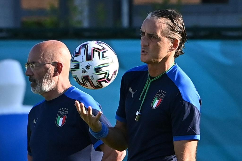 Italy coach Roberto Mancini (right) is eyeing the Euro 2020 knockout phase