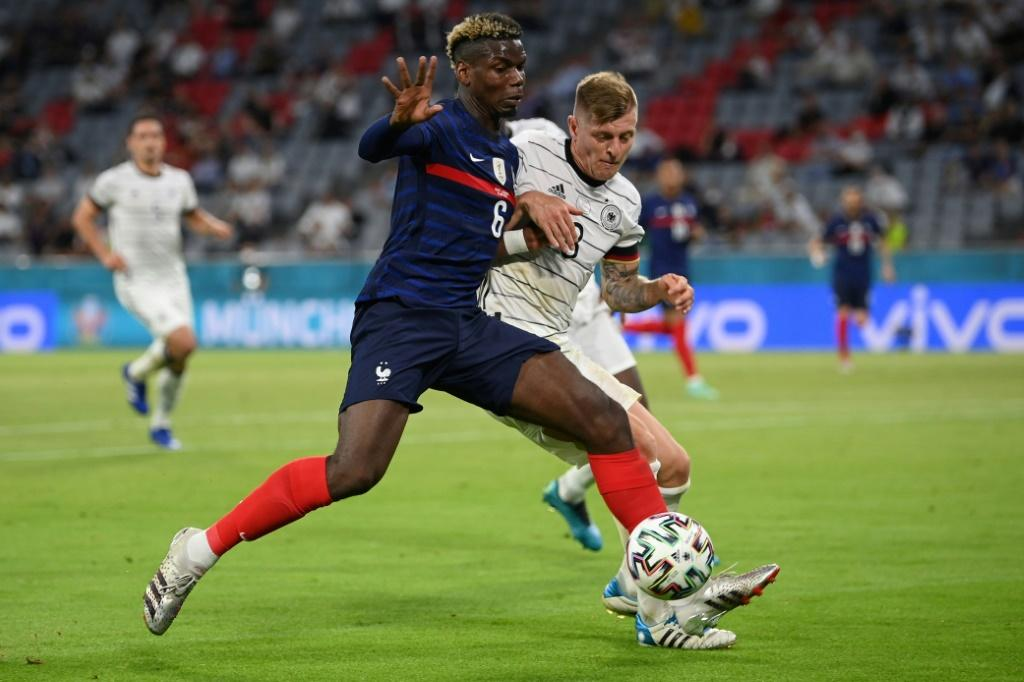 Paul Pogba holds off Toni Kroos during France's 1-0 win over Germany in Munich