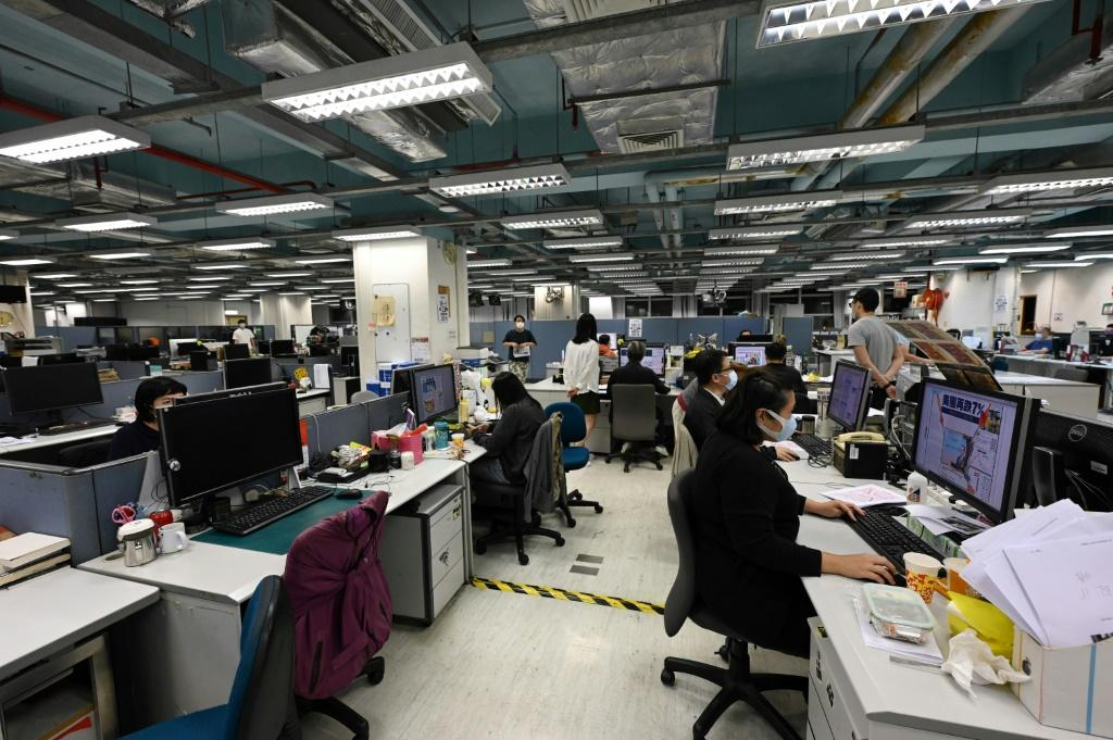 Police have raided the Apple Daily newsroom for a second time in the latest hammer blow to the outspoken tabloid