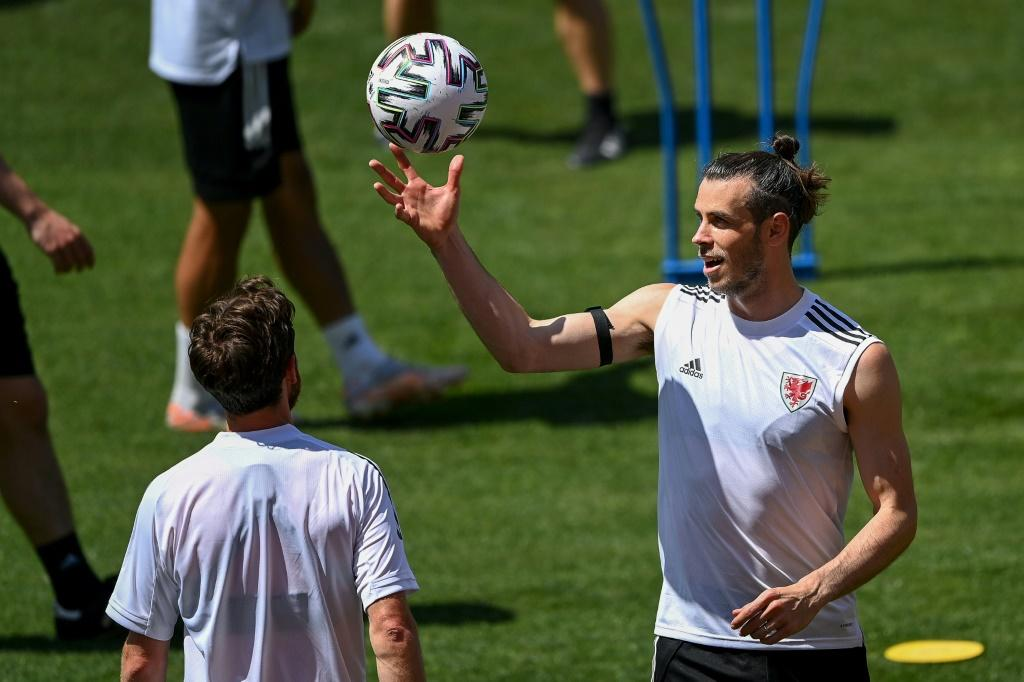 Wales captain Gareth Bale (right) takes part in a training session in Baku