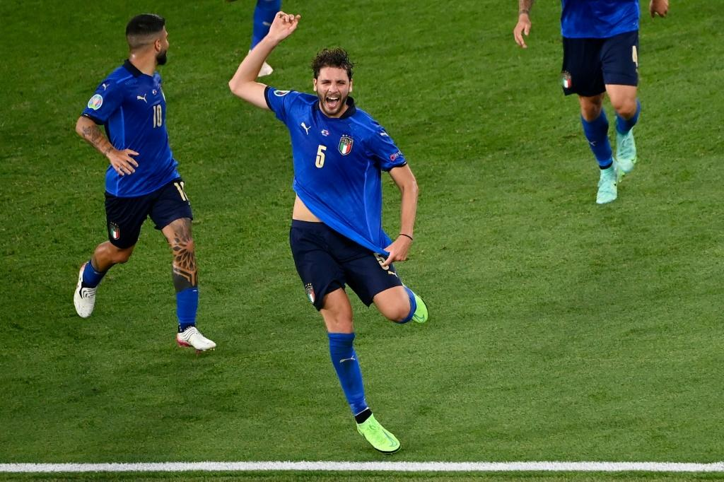 Manuel Locatelli scored twice as Italy swept into the last 16 with a game to spare