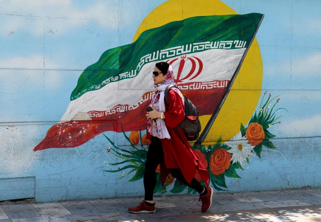 Turnout in Iran's presidential election is expected to plummet to a new low in a country exhausted by a punishing regime of US economic sanctions and the Covid-19 pandemic
