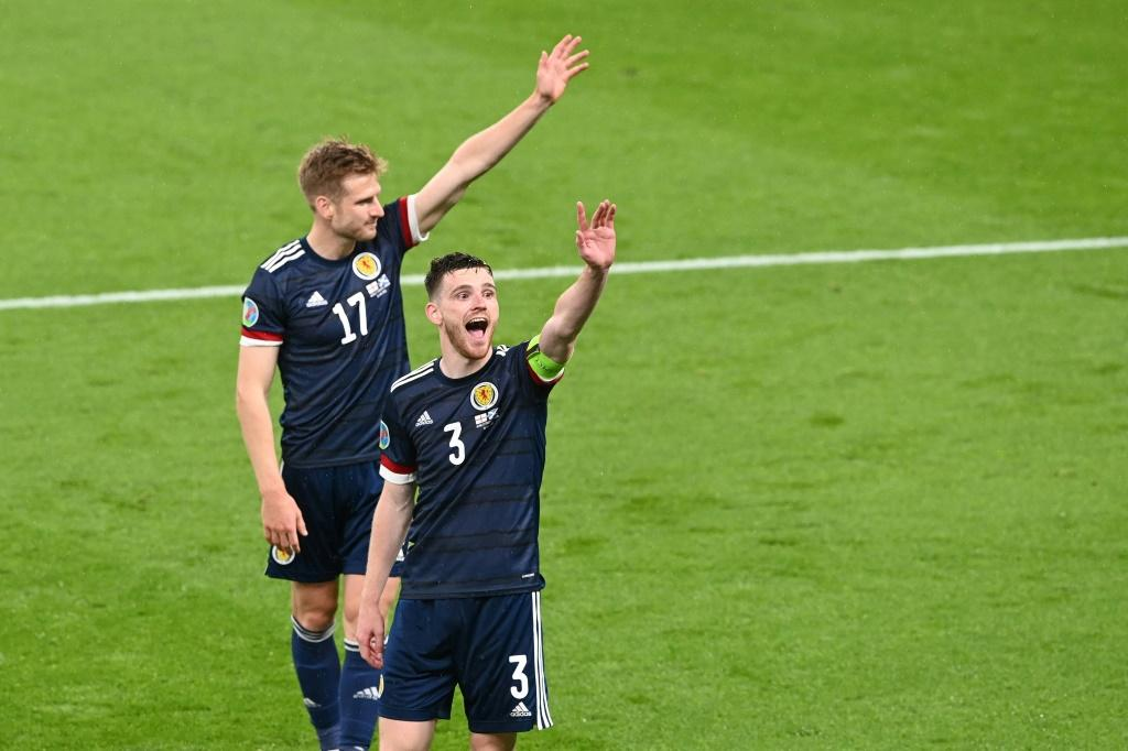 High fives: Scotland earned a 0-0 draw away to England to keep their Euro 2020 hopes alive
