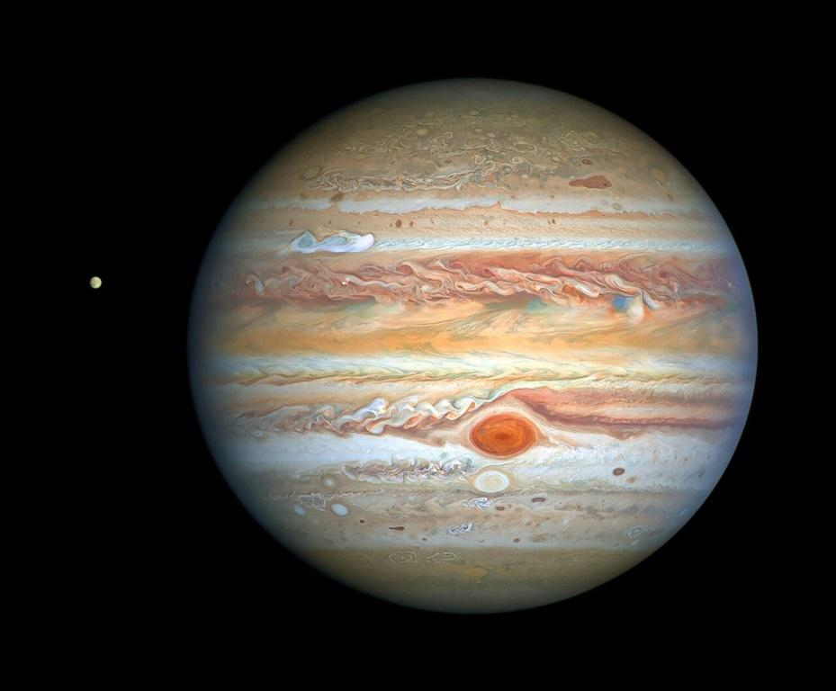 This photograph taken by the Hubble Space Telescope on August 25, 2020 shows Jupiter and its moon Europa, captured when the planet was 653 million kilometers (405 million miles) from Earth