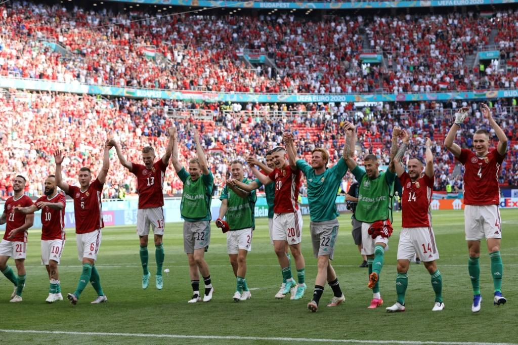 Hungary's players celebrate with their fans after holding France to a draw in Budapest
