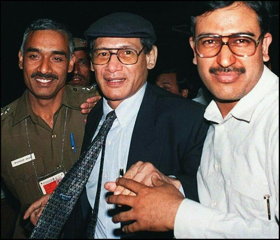 Notorious criminal Charles Sobhraj is taken to the airport in New Delhi to be deported to France in 1997