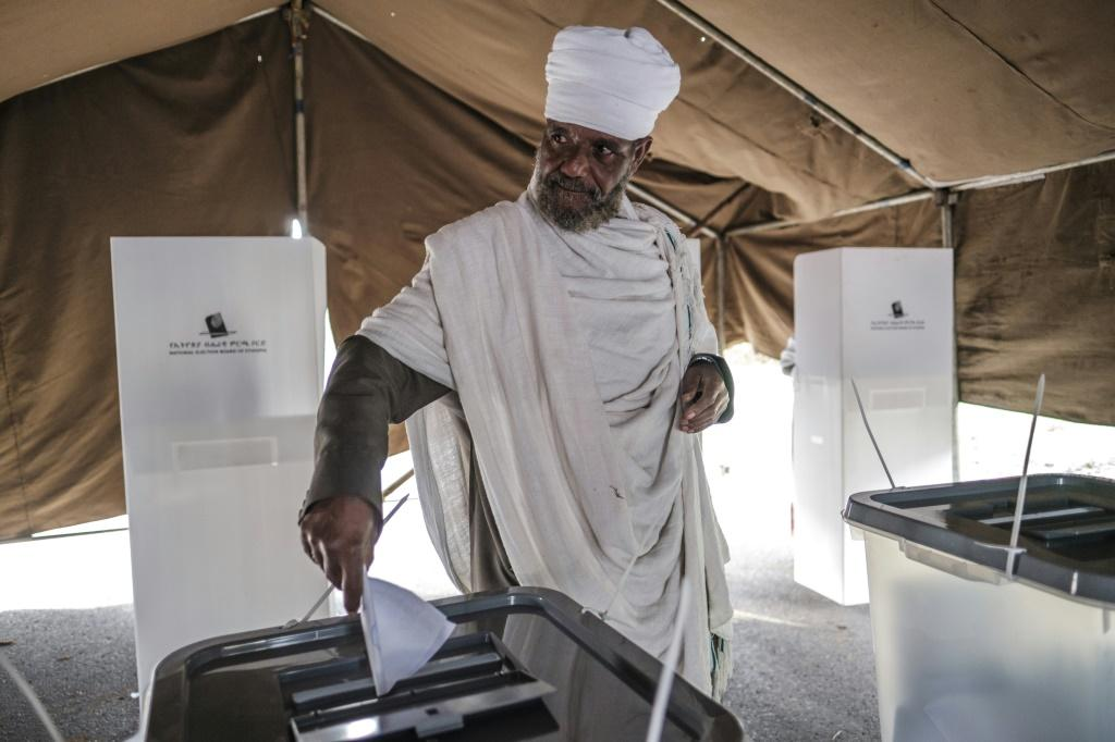 An Ethiopian Orthodox priest casts his ballot at a polling station in the city of Bahir Dar, Ethiopia
