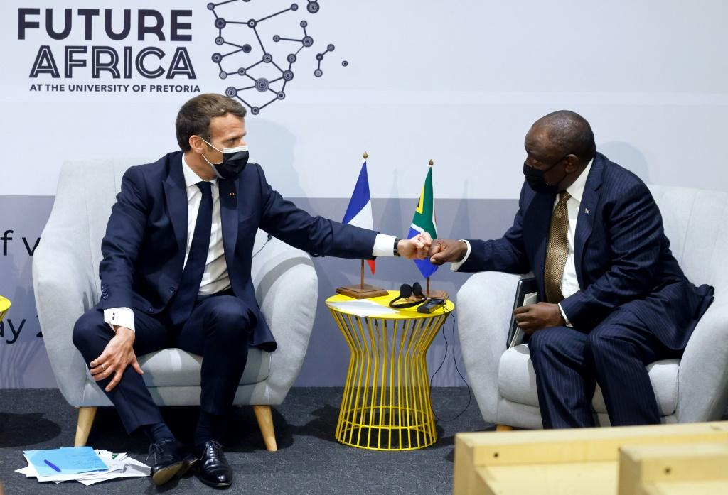 French President Emmanuel Macron, left, is backing the technology transfer initiative along with South Africa's Cyril Ramaphosa