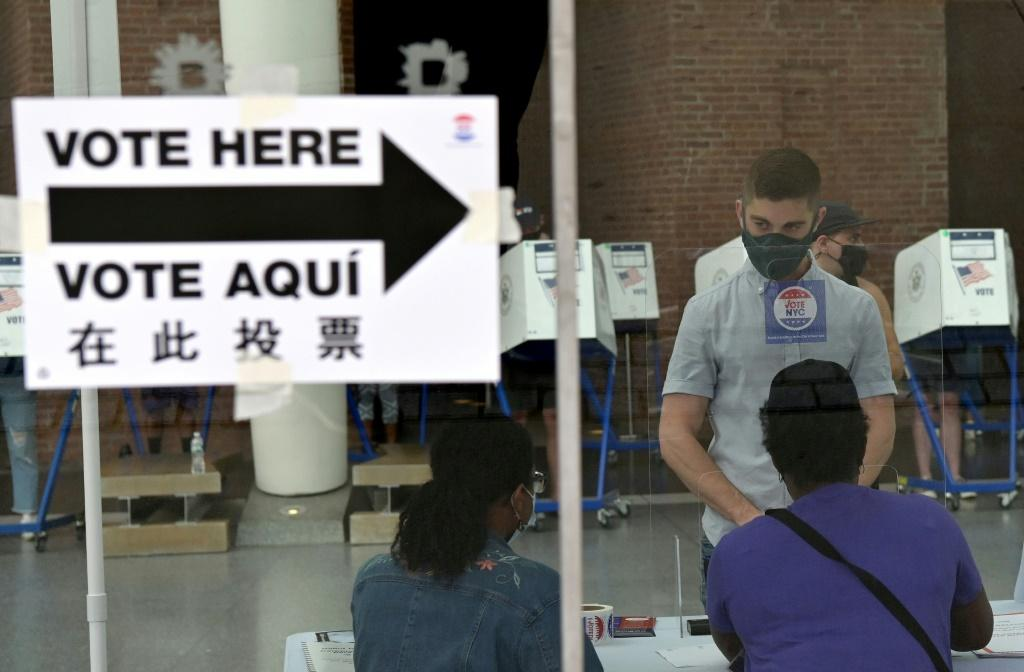 Residents vote during the New York City mayoral primary election at the Brooklyn Museum polling station on June 22, 2021 in New York City