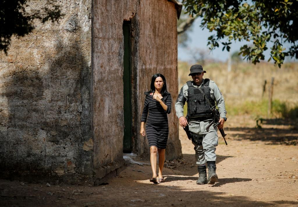 A police officer checks a house during an operation to capture Lazaro Barbosa, suspected of serial murders, in Cocalzinho de Goias, Brazil, on June 20, 2021