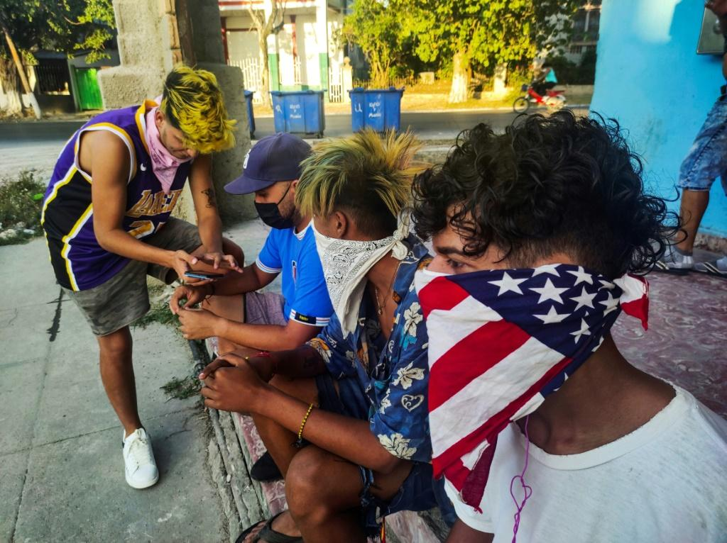 A youngster wears a handkerchief depicting the US flag as face mask, in Havana, on June 22, 2021