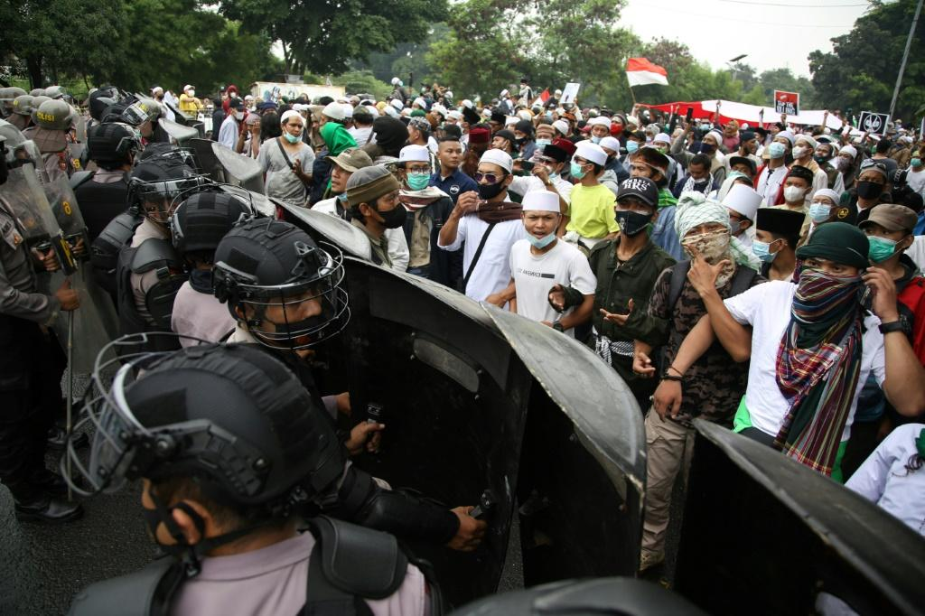 Supporters of Indonesian Muslim cleric Rizieq Shihab faced off with riot police in Jakarta