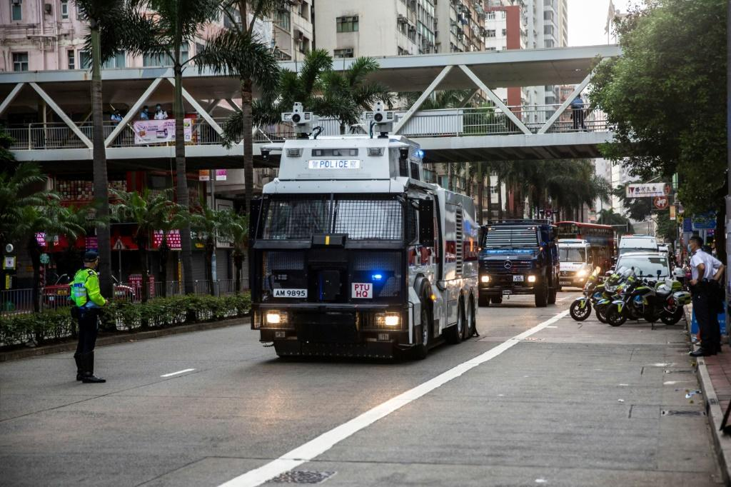 Police and water cannon trucks patrol streets near the official ceremony