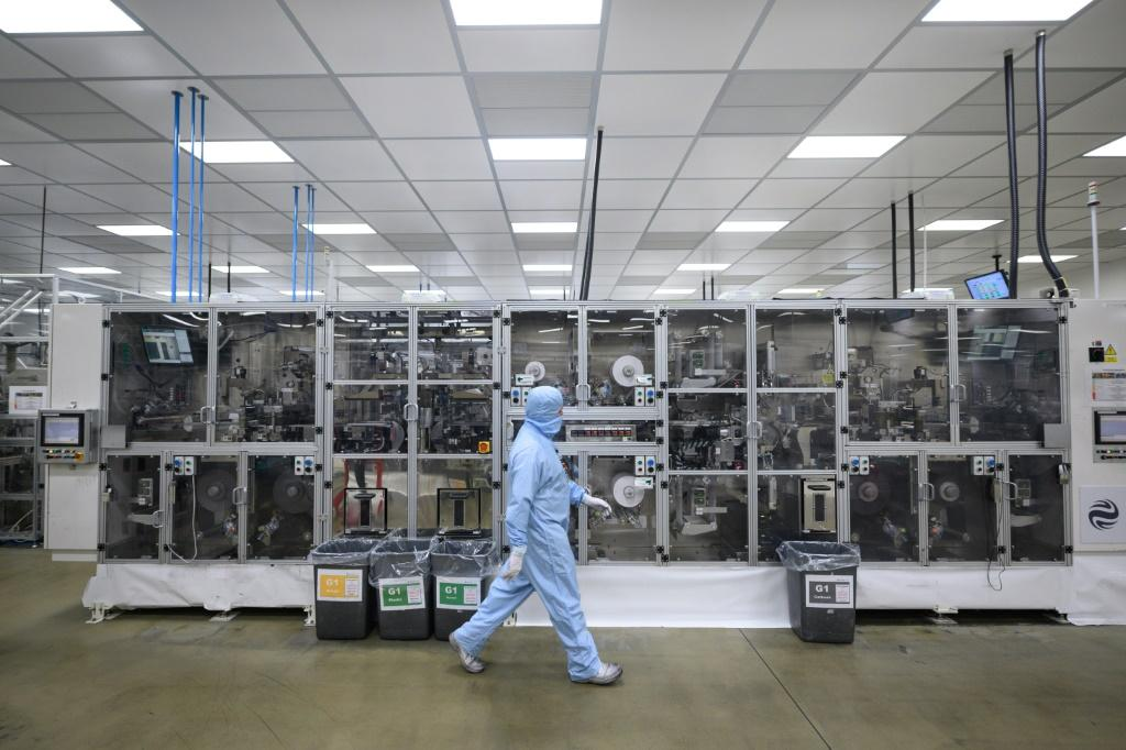 Employees work at the Envision battery manufacturing plant at Nissan's plant in Sunderland, north east England