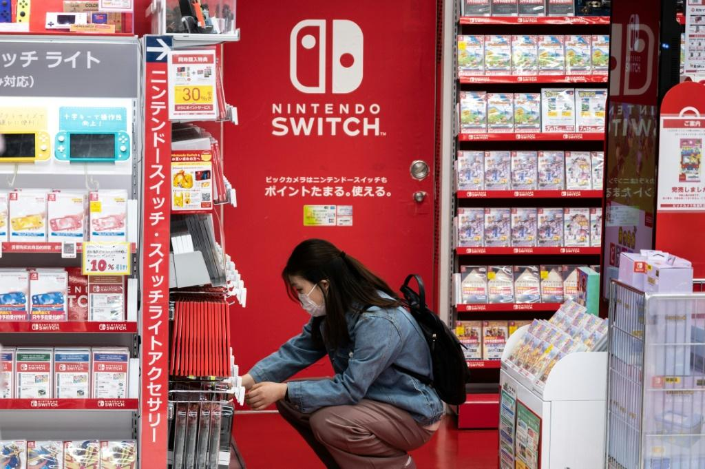 A customer browses the gaming section of Nintendo products in a shop in Tokyo on May 6, 2021