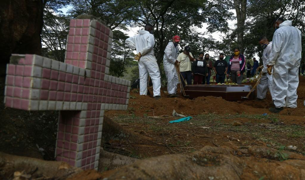 A coffin is buried at the Vila Formosa cemetery in Sao Paulo, Brazil, in April 2021, during a deadly surge of the Covid-19 pandemic: the new, even more contagious Delta variant is now circulating in Sao Paulo state, officials say