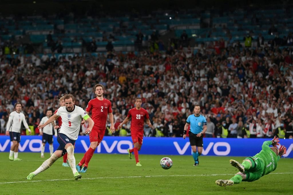 Harry Kane slams home the rebound for the winning goal after Kasper Schmeichel saved his extra-time penalty