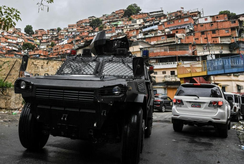 A VN-4 armored vehicle drives along one of the main streets of the Cota 905 neighborhood after two days of clashes with alleged gang members in Caracas