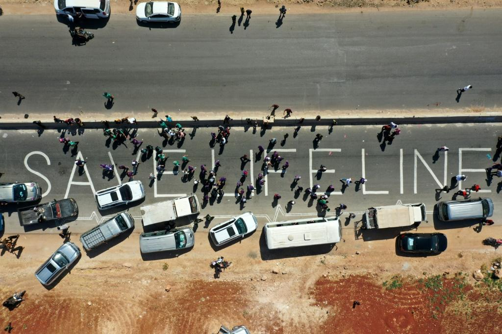 Members of civil society, humanitarian aid, medical and rescue services formed a human chain in a campaign for renewal of a UN resolution authorizing the passage of aid into Syria's rebel-held northwest on July 2, 2021