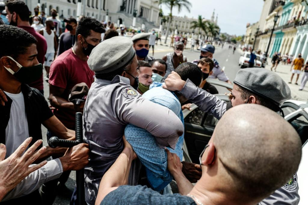 A man is arrested during a demonstration against the government of Cuban President Miguel Diaz-Canel in Havana
