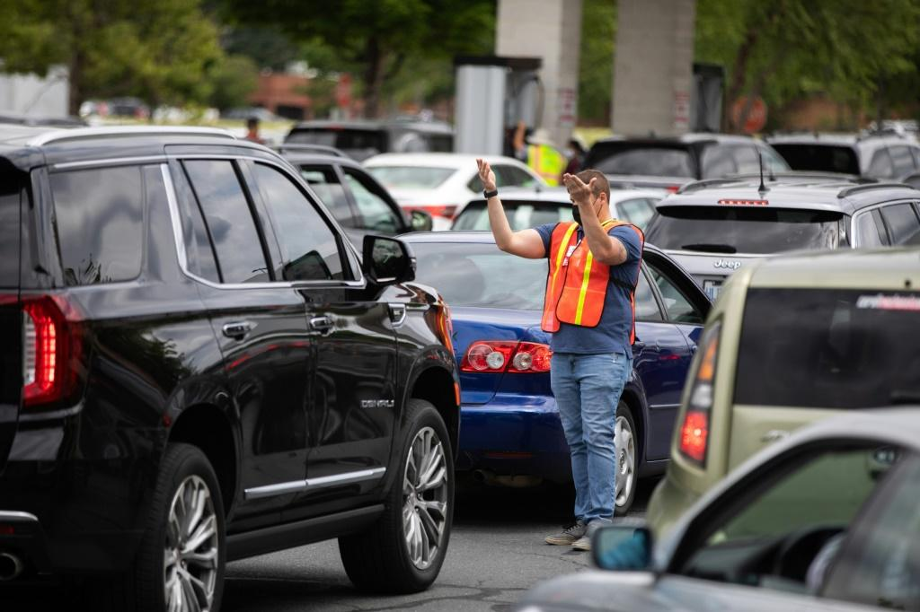 Attendants direct cars to gas pumps as they queue to fill their tanks at a Costco in Charlotte, North Carolina in May 2021 following a ransomware attack that shut down the Colonial Pipeline